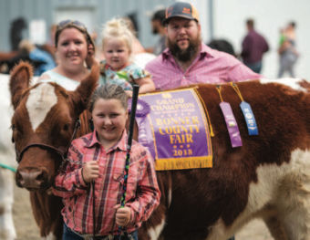 Jamie McNall Williams with family and 4-H cow