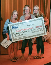 Photograph of Rotchford Family holding oversized check